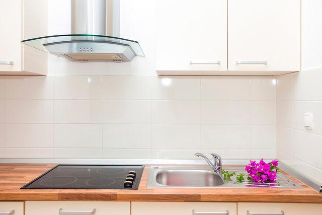 Какие вытяжки лучше для маленькой кухни? Необычные модели